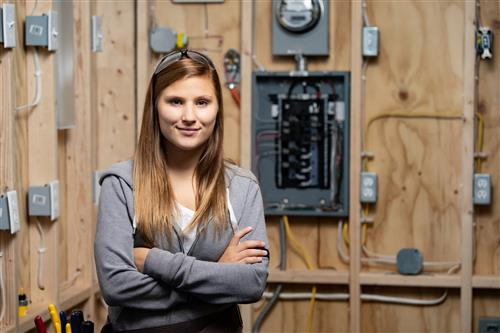 Female student working with electricity