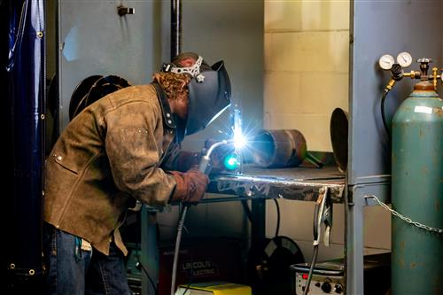 Student in Welding Lab