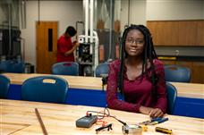 Female student working with Electrical Components