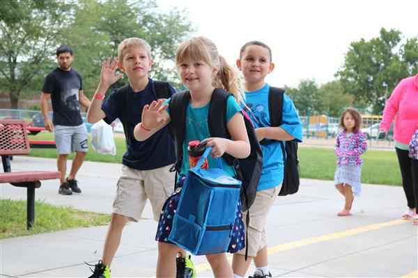 Bloomer students waving on the first day of school