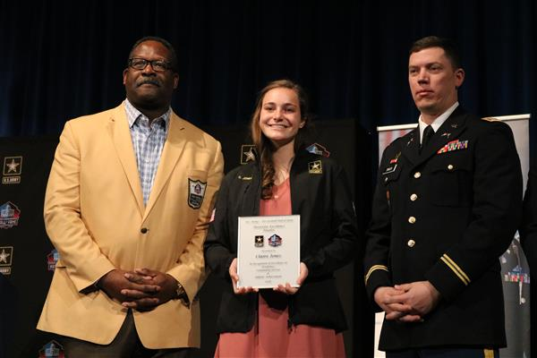 AL Senior Claire Jones receives Award of Excellence from NFL Hall of Famer Andre Tippett